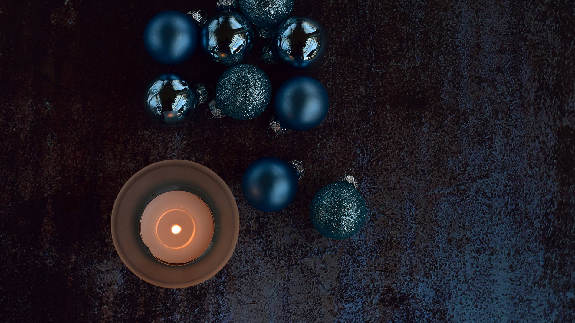 blue christmas balls with candle