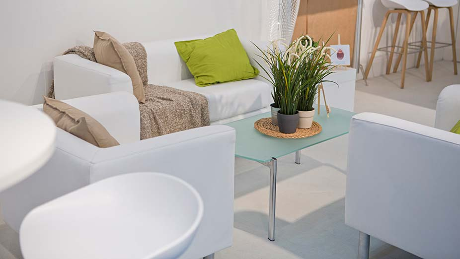 Rental furniture & equipment: White sofa with two white armchairs, a glass coffee table and white stools